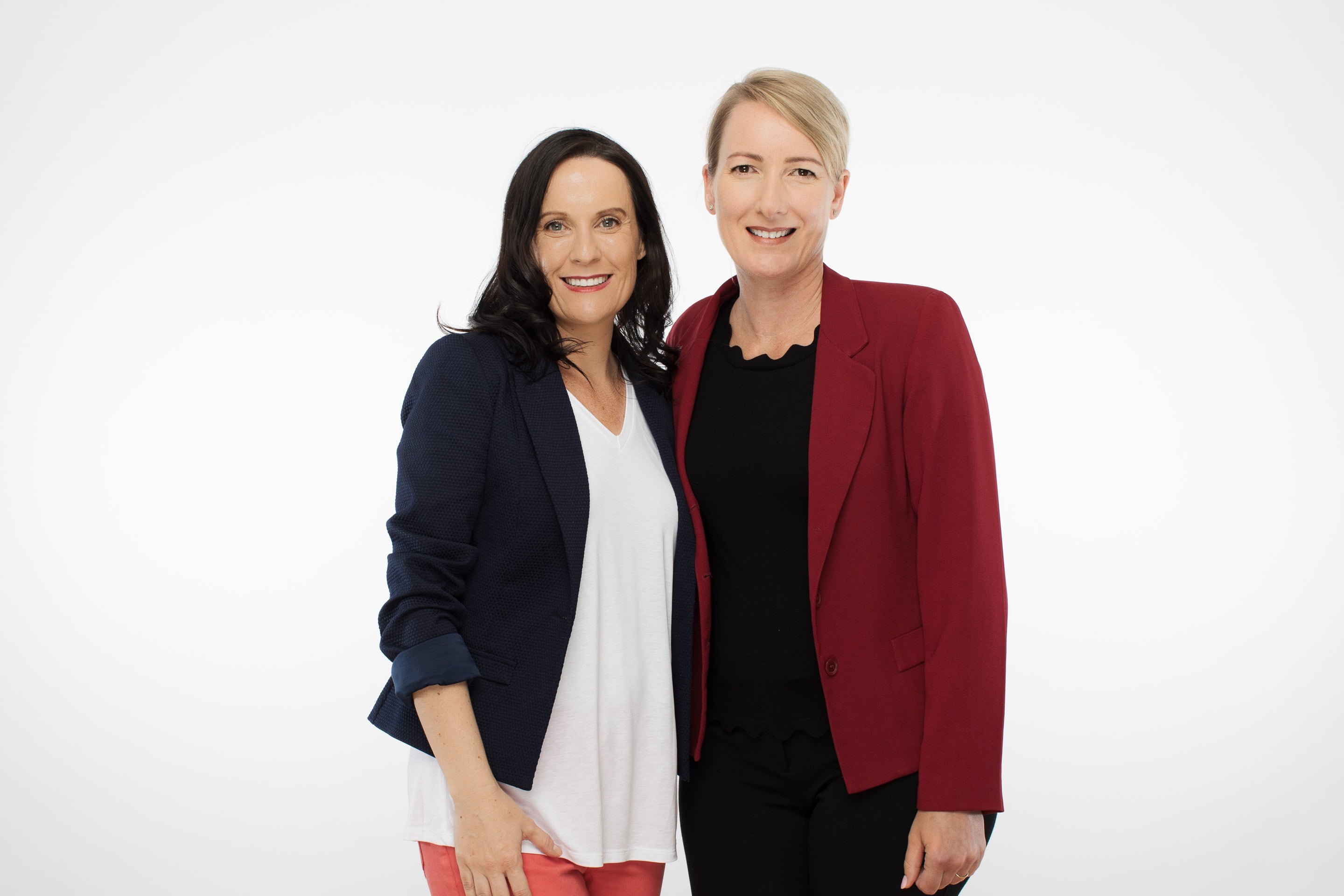 Headshot of two women against a white background